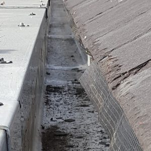 metal gutter thats leaking and needs repair with liquid rubber coating