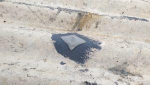 butyl tape over asbestos bolt hole repair