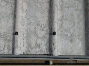 asbestos roof with bolt heads