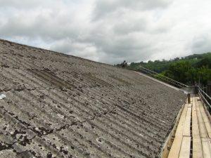 pitched asbestos roof needing repair