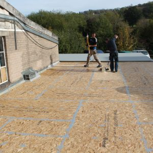 timber roof being repaired with rubber coating to protect and stop leaks