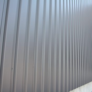 metal cladding with protective cladding