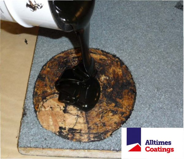 pouring liquid rubber on felt roof to make repair