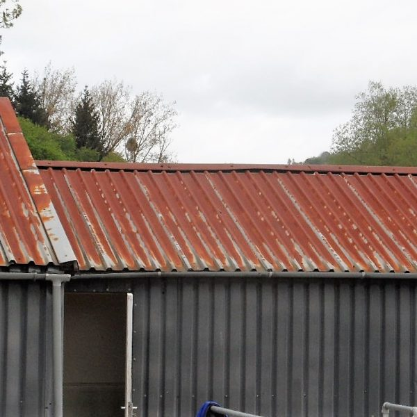 rusty metal roof that needs repairing with a liquid rubber coating to waterproof